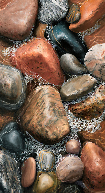 Tumbled boulders in rich earth tones have sparkling rivulets of a receding ocean wave winding between them. <br />