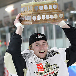 TRENTON, ON - Apr 22, 2016 -  Ontario Junior Hockey League game action between Trenton Golden Hawks and the Georgetown Raiders. Game 5 of the Buckland Cup Championship Series  at the Duncan Memorial Gardens in Trenton, Ontario. Mitch Emerson #9 of the Trenton Golden Hawks hoists the Buckland Cup.<br /> (Photo by Tim Bates / OJHL Images)