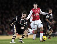 Photo: Olly Greenwood.<br />Arsenal v Charlton Athletic. The Barclays Premiership. 02/01/2007. Charlton's Bryan Hughes and Arsenal's Robin Van Persie