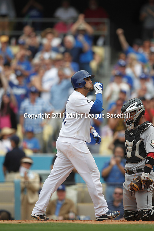 LOS ANGELES - JUNE 19:  Dioner Navarro #30 of the Los Angeles Dodgers blows a kiss to fans after hitting a home run in the bottom of the eighth inning that gives the Dodgers the margin of victory during the game against the Houston Astros at Dodger Stadium on Sunday, June 19, 2011 in Los Angeles, California.  The Dodgers defeated the Astros 1-0.  (Photo by Paul Spinelli/MLB Photos via Getty Images) *** Local Caption *** Dioner Navarro