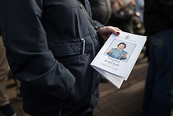 © Licensed to London News Pictures. 28/03/2018. Liverpool, UK. Fans and friends watch the Ken Dodd's funeral on a big screen outside Liverpool Cathedral . The funeral of comedian and performer Sir Ken Dodd , who died on 11th March 2018 at the age of 90 . Photo credit: Joel Goodman/LNP