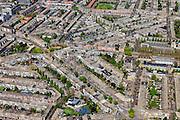 Nederland, Zuid-Holland, Den Haag, 09-05-2013; Bezuidenhout, woonwijk gebombardeerd door de geaillieerden in de Tweede Wereldoorlog Juliana van Stolberglaan (diagonaal),  zandkleurige plein midden is het Stuyvesantplein.<br /> Bezuidenhout, residential area rebuilt 50 and 60 in the years after the bombing by the Allies in World War II.<br /> luchtfoto (toeslag op standard tarieven)<br /> aerial photo (additional fee required)<br /> copyright foto/photo Siebe Swart