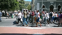 1 November 2016. <br /> CBD, Cape Town, <br /> Western Cape,<br /> South Africa.<br /> <br /> Civil Society Organisations March in Cape Town.<br /> <br /> Civil Society Organisations march through the Cape Town CBD today in protest against state capture. The group included the Social Justice Coalition (SJC) and Ndifuna Ukwazi, who handed over a memorandum to the Public Protector, the National Prosecuting Authority and the South African Revenue Service (SARS). Today's march was in response to recent developments in the political arena, including Zuma's application to block the state cap<br /> ture report.<br /> <br /> Picture by: Sive Busakwe / RealTime Images