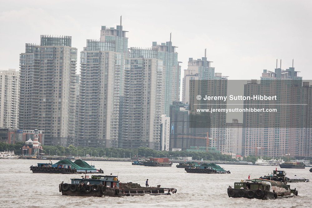 Shipping on the Hunagpu River, and a view of Pudong, from the Bund in Shanghai, China, Wednesday 6th June 2012.