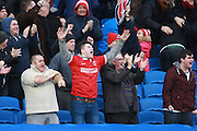 Charlton fans celebrate during the Sky Bet Championship match between Brighton and Hove Albion and Charlton Athletic at the American Express Community Stadium, Brighton and Hove, England on 5 December 2015. Photo by Bennett Dean.