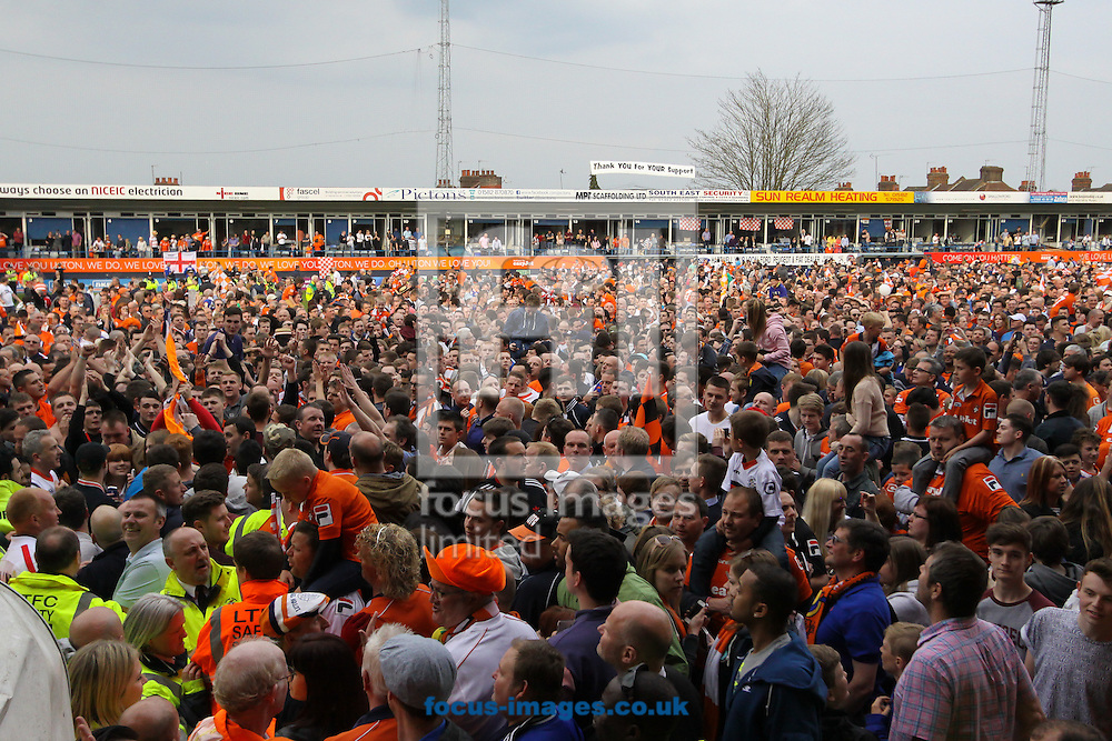 Luton Town fans invade the Kenilworth Road pitch celebrating winning the Skrill Conference Premier League Championship and returning to the Football League after five years in the fifth tier of English football after the Skrill Conference Premier match at Kenilworth Road, Luton<br /> Picture by David Horn/Focus Images Ltd +44 7545 970036<br /> 21/04/2014