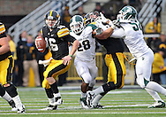 November 12, 2011: Iowa Hawkeyes quarterback James Vandenberg (16) tries to avoid Michigan State Spartans linebacker Denicos Allen (28) during the second half of the NCAA football game between the Michigan State Spartans and the Iowa Hawkeyes at Kinnick Stadium in Iowa City, Iowa on Saturday, November 12, 2011. Michigan State defeated Iowa 37-21.