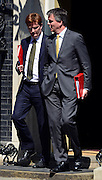 © Licensed to London News Pictures. 07/05/2013. Wesminster, UK. Danny Alexander, Liberal Democrat MP, Chief Secretary to the Treasury and Michael Moore, Liberal Democrat MP, Secretary of State for Scotland . . Ministers on Downing Street on Tuesday 7th May 2013. Photo credit : Stephen Simpson/LNP