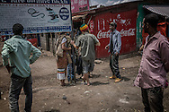 """The now timeless ritual of the local young touts versus the foreign backpacker, in this case of the wannabe barefoot Rasta variety on the main highway in """"Jamaica"""".  Shashemene, Ethiopia."""