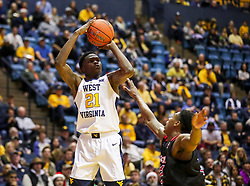 Dec 22, 2018; Morgantown, WV, USA; West Virginia Mountaineers forward Wesley Harris (21) shoots a three pointer during the second half against the Jacksonville State Gamecocks at WVU Coliseum. Mandatory Credit: Ben Queen-USA TODAY Sports