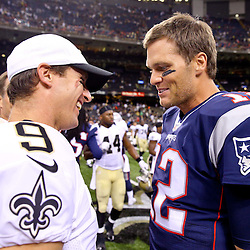 Aug 22, 2015; New Orleans, LA, USA; New Orleans Saints quarterback Drew Brees (9) and New England Patriots quarterback Tom Brady (12) talk after a preseason game at the Mercedes-Benz Superdome. The Patriots defeated the Saints 26-24. Mandatory Credit: Derick E. Hingle-USA TODAY Sports