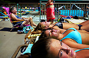 On a warm afternoon, (F-B) Jamie Deveney, Alyssa D'Emilio and Kelsey Scott sunbathe, chat and watch the goings on at Padonia Pool Club. The three 15-year olds spend much of there time at the private pool.