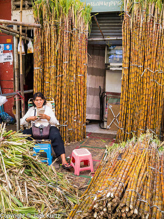 02 FEBRUARY 2013 - PHNOM PENH, CAMBODIA:  Sugar cane for sale in a market in Phnom Penh, Cambodia.      PHOTO BY JACK KURTZ