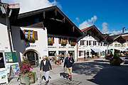 MITTENWALD, GERMANY - SEPTEMBER 01, 2010: Unidentified tourists walk by the street of Mittenwald, Germany.