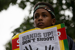 "© Licensed to London News Pictures. 27/08/2014. London, UK. Demonstrators from Stand up to Racism take part in a ""Hands Up, Don't Shoot, Justice for Michael Brown"" protest outside the US Embassy in London on 27th August 2014. The unarmed black teenager, Michael Brown was fatally shot by a white police officer in Ferguson, Missouri in the United States (US) of America on 9th August 2014.. Photo credit : Vickie Flores/LNP"
