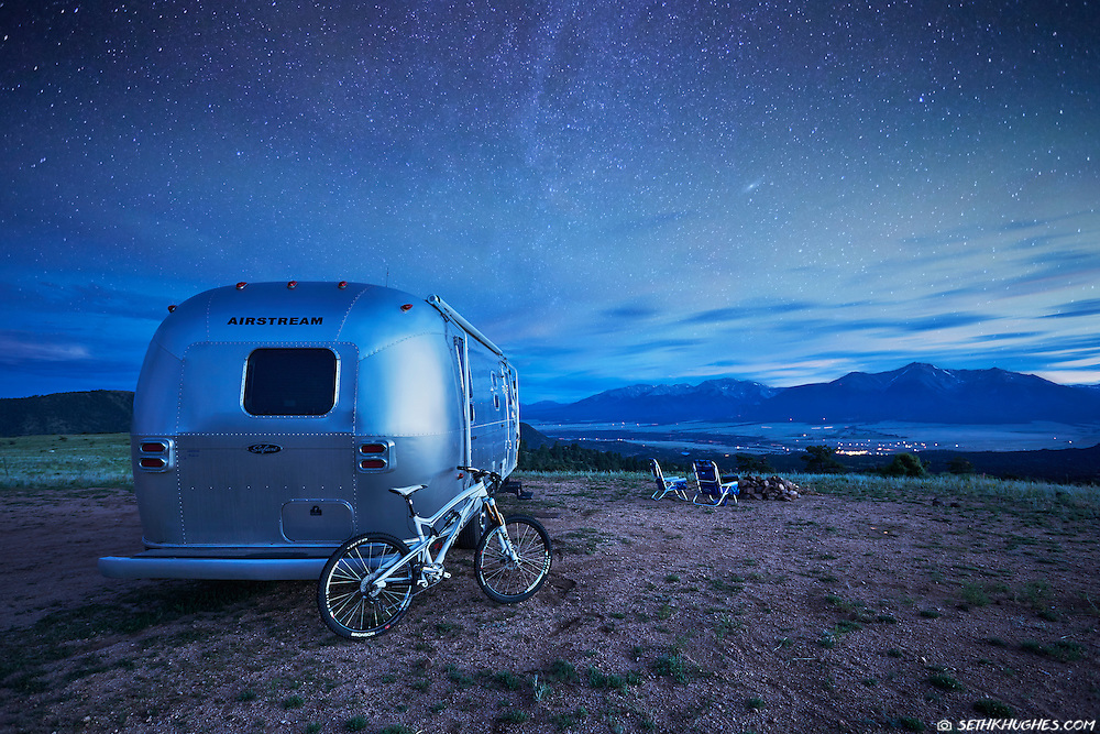 An Airstream trailer parked with a view of the Collegiate Peaks near Buena Vista, Colorado.