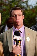 Jan 8, 2016; Scottsdale, AZ, USA; Clemson Tigers head coach Dabo Swinney talks with an ESPN reporter after arriving to the Hyatt Regency Scottsdale Resort at Gainey Ranch. Mandatory Credit: Jennifer Stewart-USA TODAY Sports