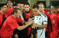 Ermin Rakovic, captain of Interblock with a champaign, at left club president Joc Pececnik, Suvad Grabus and Zoran Zeljkovic, right Erik Salkic,  at Slovenian Supercup between NK Domzale and NK Interblock, on July 9, 2008, in Domzale. Interblock won the mach and Supercup by 7 : 6 after penalty shots. (Photo by Vid Ponikvar / Sportal Images)