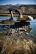 Construction crews divert the Truckee River back to its original course on December 2, 2009 in Mustang, NV.