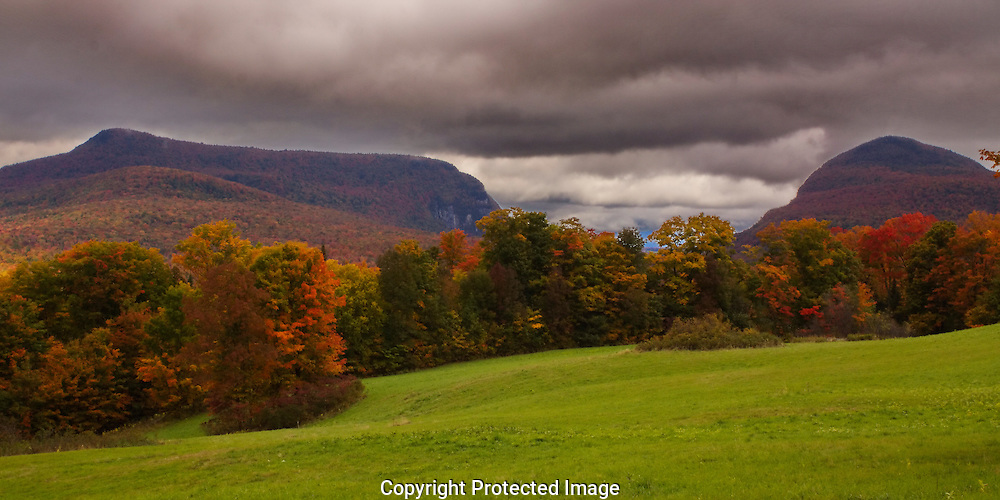 Cloudy but colorful Fall day in Burke, VT, Northeast Kingdom.  Mountains in the background nestle Lake Willoughby between them.