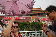 Chinese tourists in front of the Forbidden City, in Beijing.