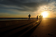 GOLD COAST, AUSTRALIA - APRIL 19:  Competitors run on the beach prior to the start of day three of the 2013 Australian National Surf Lifesaving Titles  on April 19, 2013 on the Gold Coast, Australia.  (Photo by Matt Roberts/Getty Images)