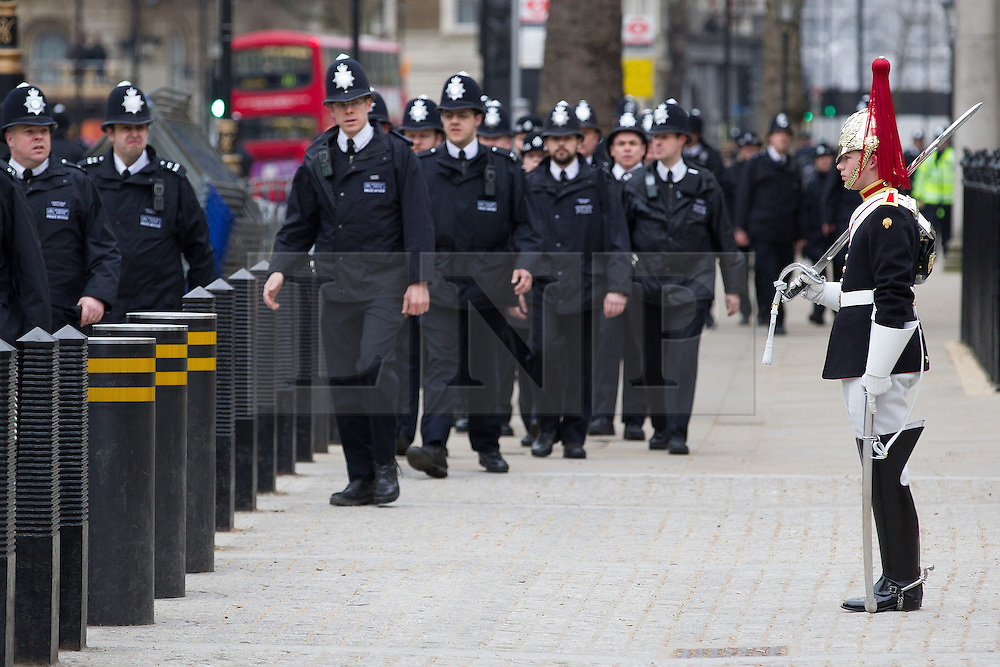 © Licensed to London News Pictures . 17/04/2013 . London , UK . Police walk up Whitehall passed Admiralty Arch . The funeral of former British Conservative Prime Minister , Baroness Margaret Thatcher , today (Wednesday 17th April 2013) in Central London . Baroness Thatcher died from a stroke at the age of 87 . Photo credit : Joel Goodman/LNP