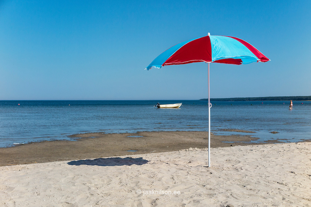 Beach umbrella on Võsu beach at Baltic sea, Estonia
