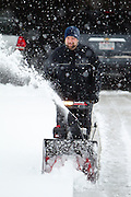 Matt Ludtke snow blows his driveway  in Green Bay, Wisconsin during a snow strom in March 2011.(Photo by Mike Roemer)