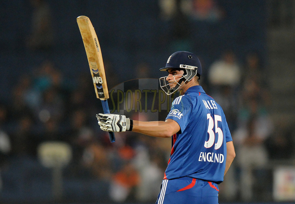 Alex Hales of England raises his bat after scoring a half century during the first Airtel T20 Match between India and England held at Subrata Roy Sahara stadium in Pune on the  20th December 2012..Photo by  Pal Pillai/BCCI/SPORTZPICS .