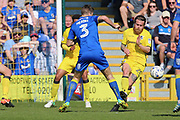 Bristol Rovers midfielder Stuart Sinclair (24) fouling AFC Wimbledon defender Jon Meades (3) during the EFL Sky Bet League 1 match between AFC Wimbledon and Bristol Rovers at the Cherry Red Records Stadium, Kingston, England on 8 April 2017. Photo by Matthew Redman.