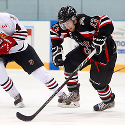 NEWMARKET, ON - Feb 4 : Ontario Junior Hockey League Game Action between the Stouffville Spirit and the Newmarket Hurricanes, Michael Morgan #13 of the Stouffville Spirit Hockey Club skates with the puck during third period game action.<br /> (Photo by Brian Watts / OJHL Images)