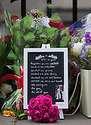 UNITED KINGDOM, London: 7 July 2015 Flowers and messages are left by a plaque as friends and family of the victims of the July the 7th bombing in London mourn and pay there respects at the spot where the number 30 bus was attacked on the ten year anniversary at Tavistock Square in London, England. Andrew Cowie / Story Picture Agency