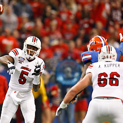 Jan 2, 2013; New Orleans, LA, USA; Louisville Cardinals quarterback Teddy Bridgewater (5) throws a pass against the Florida Gators during the first quarter of the Sugar Bowl at the Mercedes-Benz Superdome.  Mandatory Credit: Derick E. Hingle-USA TODAY Sports