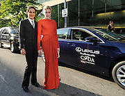 Designer Zac Posen and actress Greta Gerwig arrive in a Lexus to the CFDA 2014 Fashion Awards, Monday June 2, 2014 in New York. (Photo by Diane Bondareff/Invision for Lexus/AP Images)