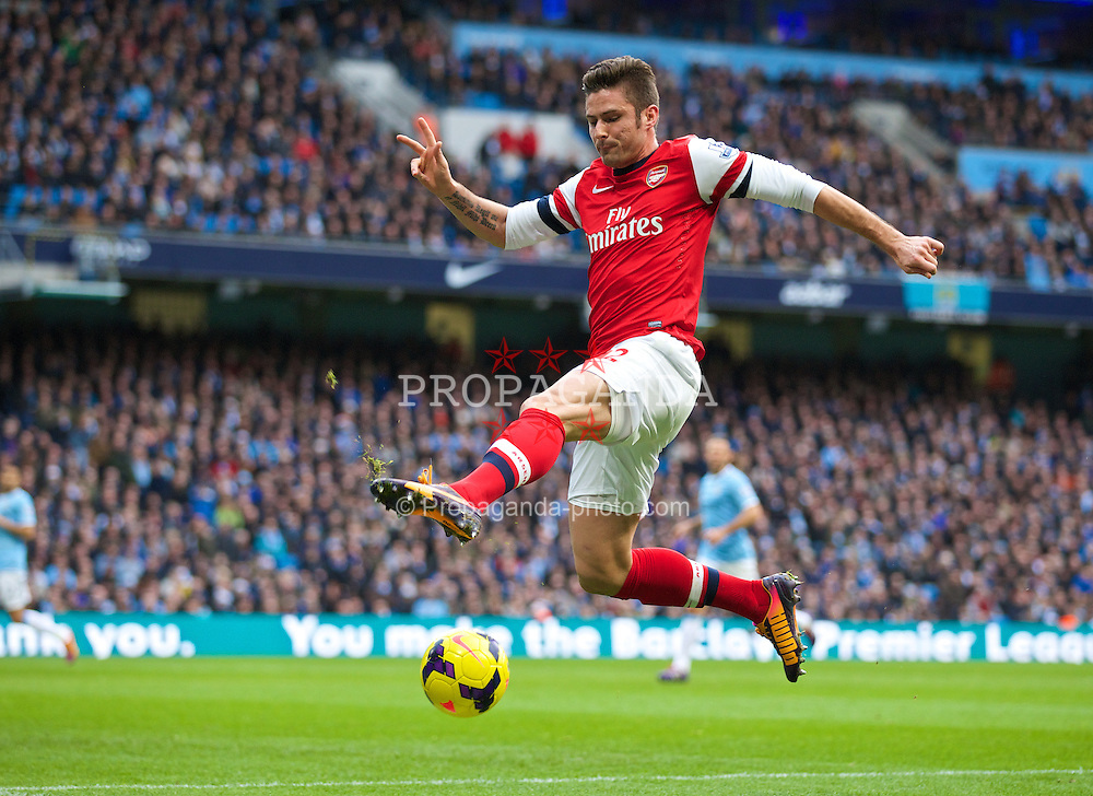 MANCHESTER, ENGLAND - Saturday, December 14, 2013: Arsenal's Oliver Giroud in action against Manchester City during the Premiership match at the City of Manchester Stadium. (Pic by David Rawcliffe/Propaganda)