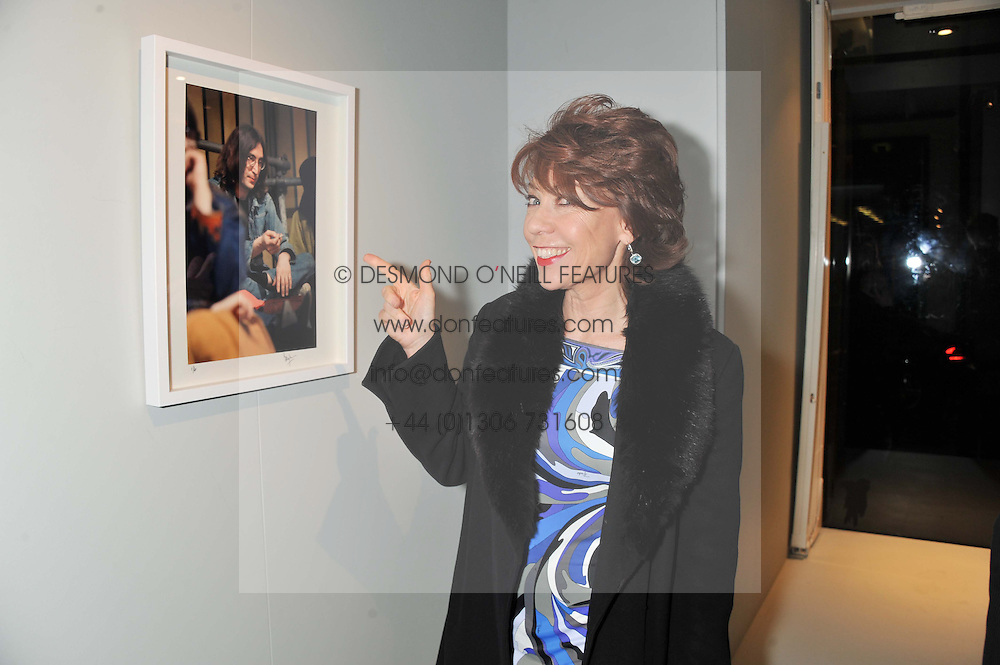 KATHY LETTE at a private view of Bill Wyman - Reworked held at the Rook & Raven Gallery, 7 Rathbone Place, London W1 on 26th February 2013.