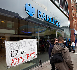 © licensed to London News Pictures. Manchester, UK  07/05/11. UKUncut and anti-war protesters on Manchester's Market Street forced Barclays Bank to close this (Saturday 7th May) afternoon. Protesters say Barclays supports the arms trade by providing financial services to arms component manufacturers. Please see special instructions for usage rates. Photo credit should read Joel Goodman/LNP