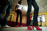 Nana Yaa Adadewa Addo (center), 24, waits in line with other models during a rehearsal where models come to practice their catwalk in Ghana's capital Accra on Thursday May 21, 2009. Nana Yaa is one of several Ghanaian girls who auditioned for the upcoming television show West Africa's Next Top Model, the latest incarnation of Tyra Banks' America's Next Top Model.