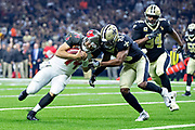 NEW ORLEANS, LA - SEPTEMBER 9:  Ryan Fitzpatrick #14 of the Tampa Bay Buccaneers runs the ball for a touchdown and is hit by Marcus Williams #43 of the New Orleans Saints at Mercedes-Benz Superdome on September 9, 2018 in New Orleans, Louisiana.  The Buccaneers defeated the Saints 48-40.  (Photo by Wesley Hitt/Getty Images) *** Local Caption *** Ryan Fitzpatrick; Marcus Williams