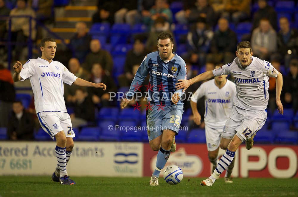 BIRKENHEAD, ENGLAND - Tuesday, March 6, 2012: Tranmere Rovers' goalkeeper Paul Rachubka in action against Notts County's Ben Burgess during the Football League One match at Prenton Park. (Pic by David Rawcliffe/Propaganda)