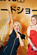 Singer and actress Christina Aguilera (L) and actress Kristen Bell attend a red carpet event to promote their film Burlesque in Tokyo, Japan on Dec. 8 2010.