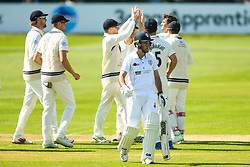 Wayne Madsen of Derbyshire cuts a dejected figure as he loses his wicket for 47 to Tim Murtagh of Middlesex who celebrates with teammates- Mandatory by-line: Robbie Stephenson/JMP - 20/04/2018 - CRICKET - The 3aaa County Ground  - Derby, England - Derbyshire CCC v Middlesex CCC - Specsavers County Championship Division Two