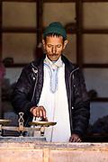 ASSAISS, MOROCCO - October 28th 2015 - A trader weighs saffron stigmas for a customer at the Assaiss market, Taliouine, Morocco