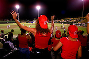 024212.SP.0117.domgame8.kc--San Pedro de Macor, Dominican Republican--Leones del Escogido(Lions of Escogido) against Estrellas de Oriente(Stars of the East). Cheerleaders from the visiting team Leones de Escogido do their bit of whooping it up after their team scores three runs in the fifth inning.  Escogido played Estrellas in the best-of-seven series.