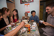 Chen Zhen, 20, law student in Shanghai China at home on the weekend with her father, grandmother and grandfather at dinner.  She eats at KFC 3 times a week during the school week. (Chen Zhen is featured in the book What I Eat: Around the World in 80 Diets).