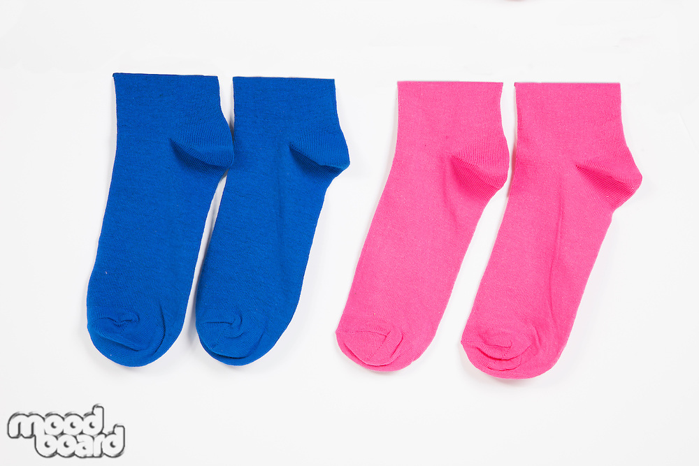 Close-up of socks hanging over white background