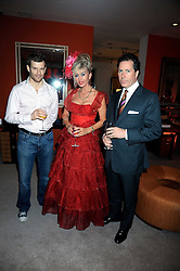 Left to right, TOM AIKENS, SALLY FARMILOE and VISCOUNT LINLEY at the Linley Christmas party at their store at 60 Pimlico Road, London on 19th November 2008.