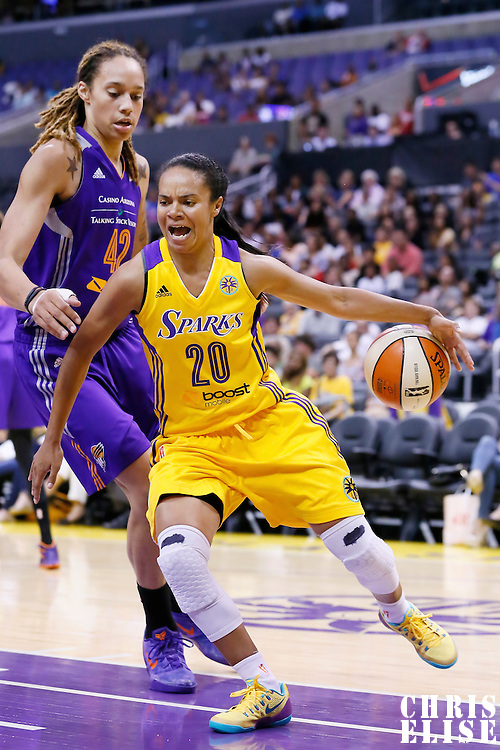 24 July 2014: Los Angeles Sparks guard Kristi Toliver (20) drives past Phoenix Mercury center Brittney Griner (42) during the Phoenix Mercury 93-73 victory over the Los Angeles Sparks, at the Staples Center, Los Angeles, California, USA.