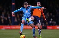 Michael Harriman of Luton Town (right) and Johnny Hunt of Cambridge United (left) battle for the ball during the Sky Bet League 2 match at Kenilworth Road, Luton<br /> Picture by David Horn/Focus Images Ltd +44 7545 970036<br /> 31/01/2015